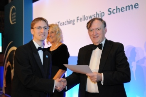Dr Christopher Wiley receiving his award during the National Teaching Fellowship ceremony
